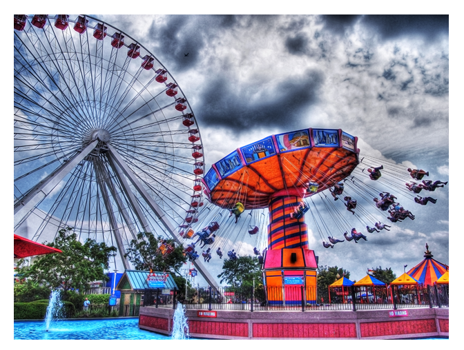 Picture of a theme park ferris wheel and swing